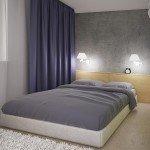 бетонная стена в спальне, двухспальная кровать на мягком основании, сочетание синего и зеленого в интерьере, изголовье в качестве тумбочки
